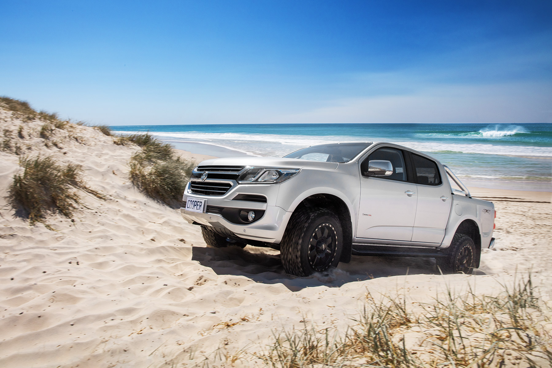 4WD on Australian beach during summer