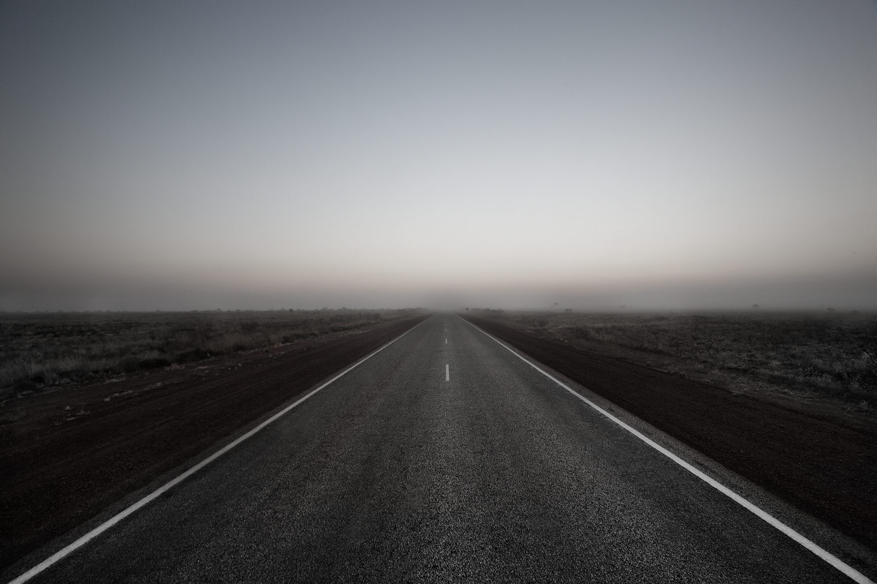 Outback road in Western Australia at dawn